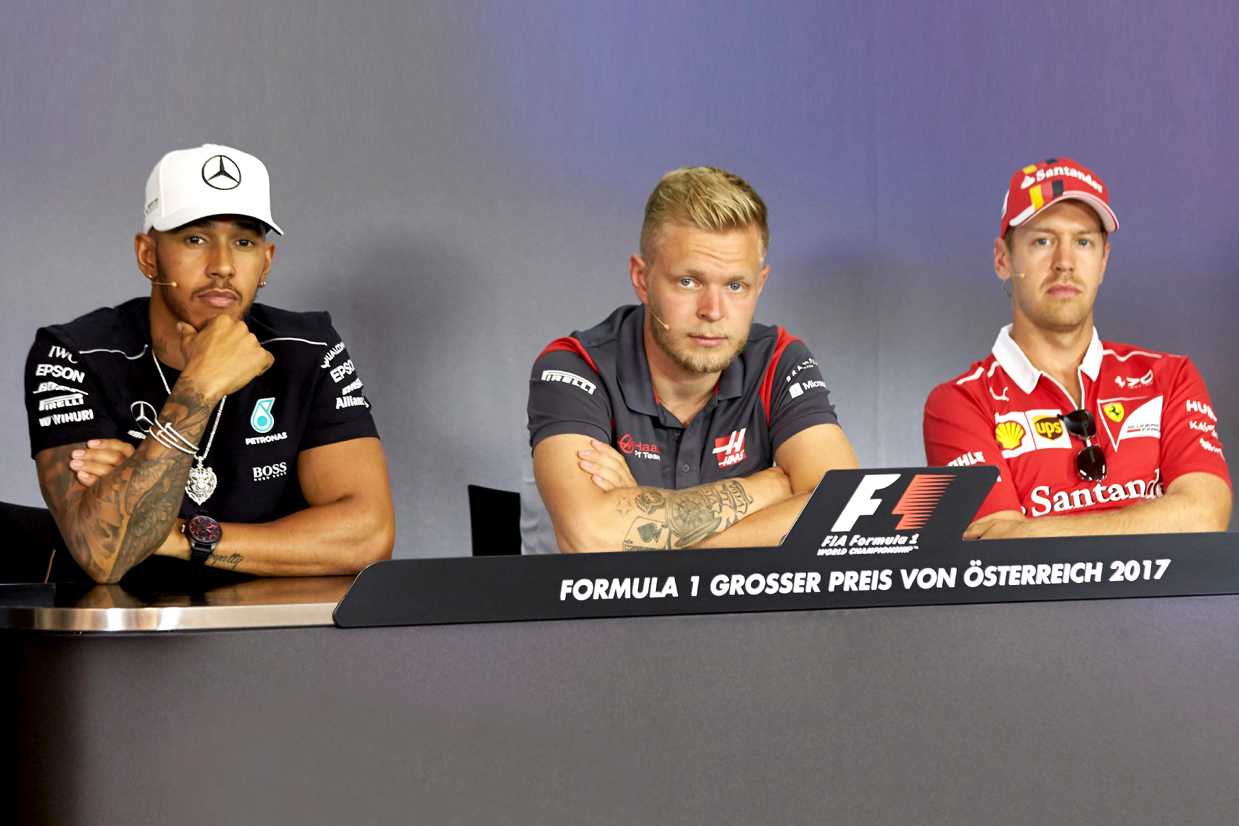 Lewis Hamilton, Kvin Magnussen and Sebastian Vettel sit in the Thursday press conference at the Austrian Grand Prix.
