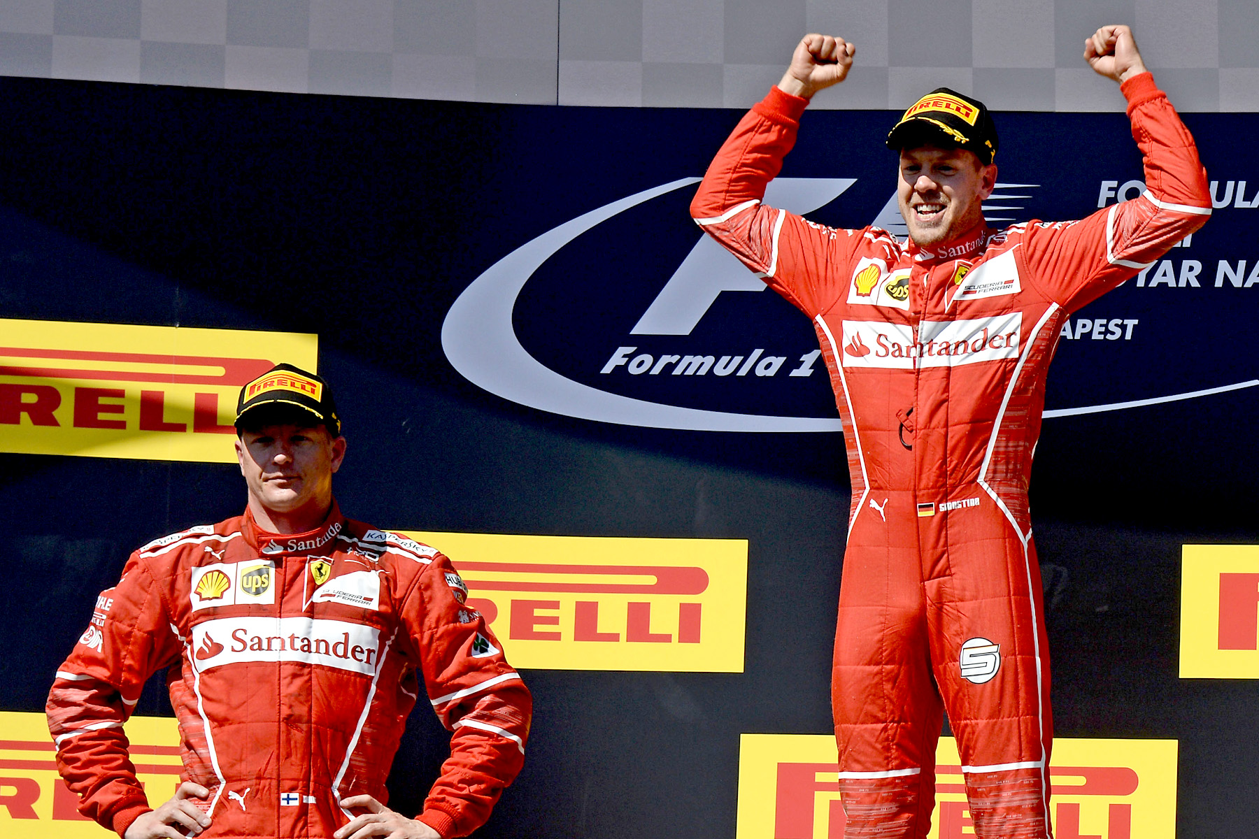 Sebastian Vettel and Kimi Raikkonen celebrate on the 2017 Hungarian Grand Prix podium.