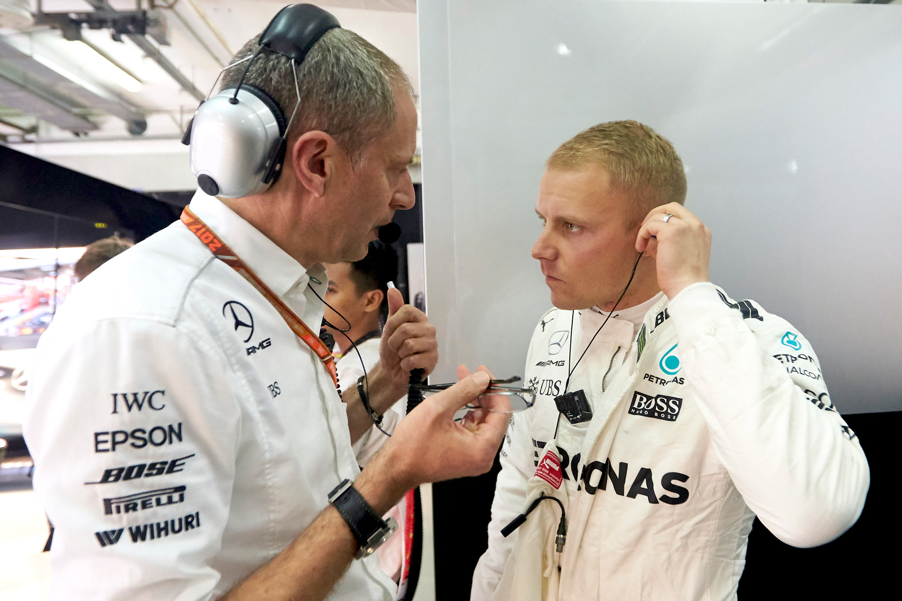 Valtteri Bottas talks to an engineer at the 2017 Malaysian Grand Prix.