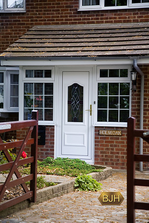 Black Composite Front Door With Flanking Cream Pvc U Sliding Sash Window A Nod To The