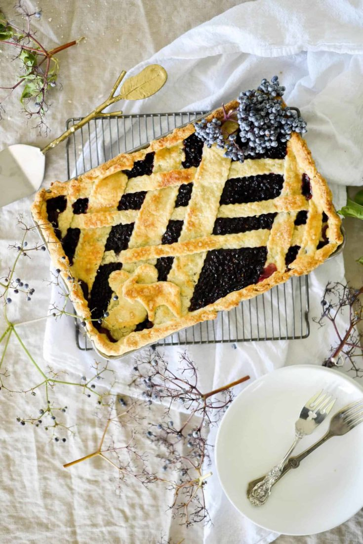 Elderberry pie with lattice detailed crust.