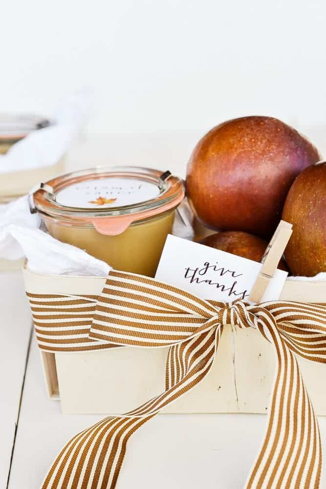 Homemade gift basket for fall with apples and caramel sauce