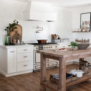 Farmhouse Kitchen with Wood Island and White Shaker Cabinets with White Concrete Countertops
