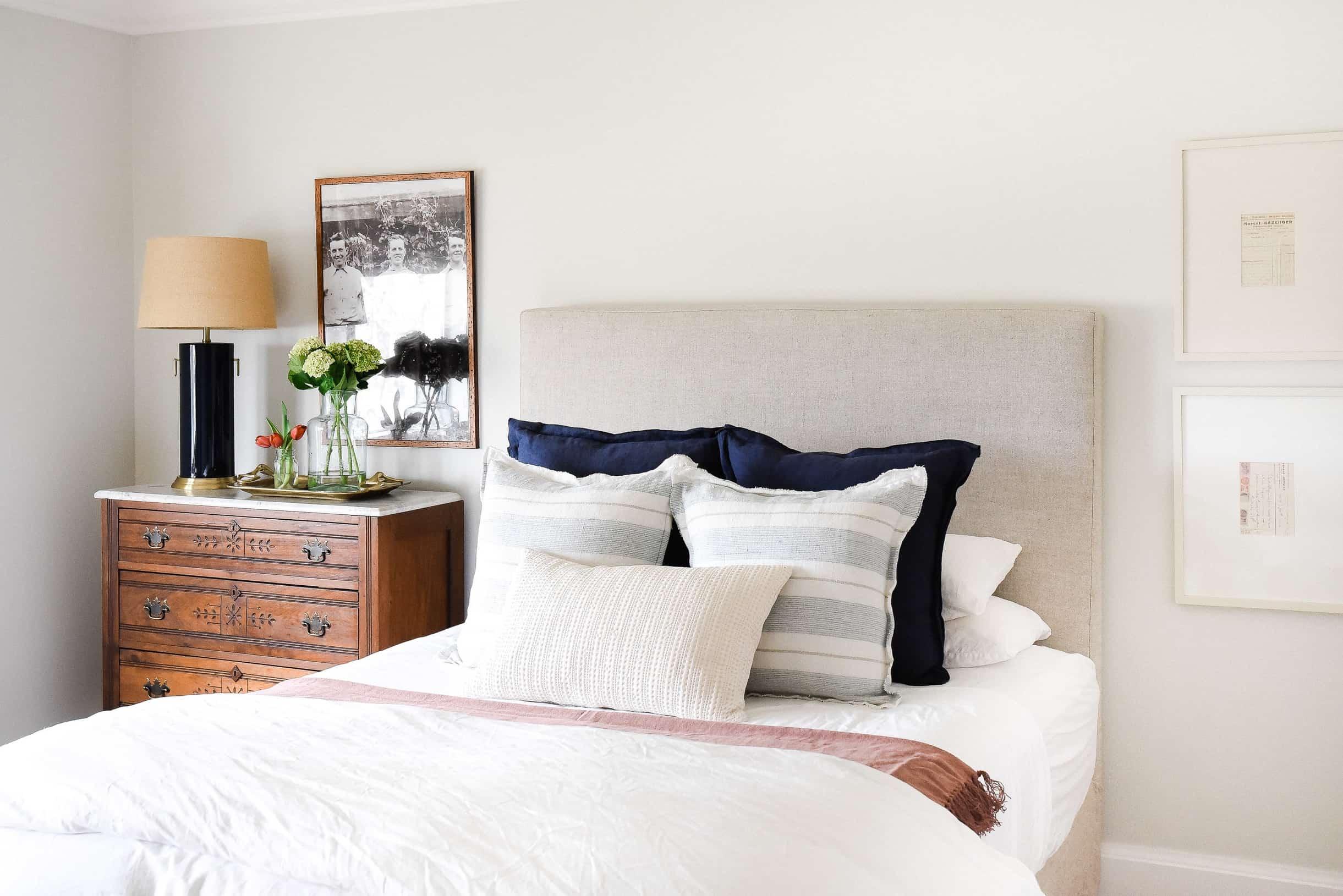 Create a farmhouse bedroom with a mix of antique farmhouse furniture and modern farmhouse decor!