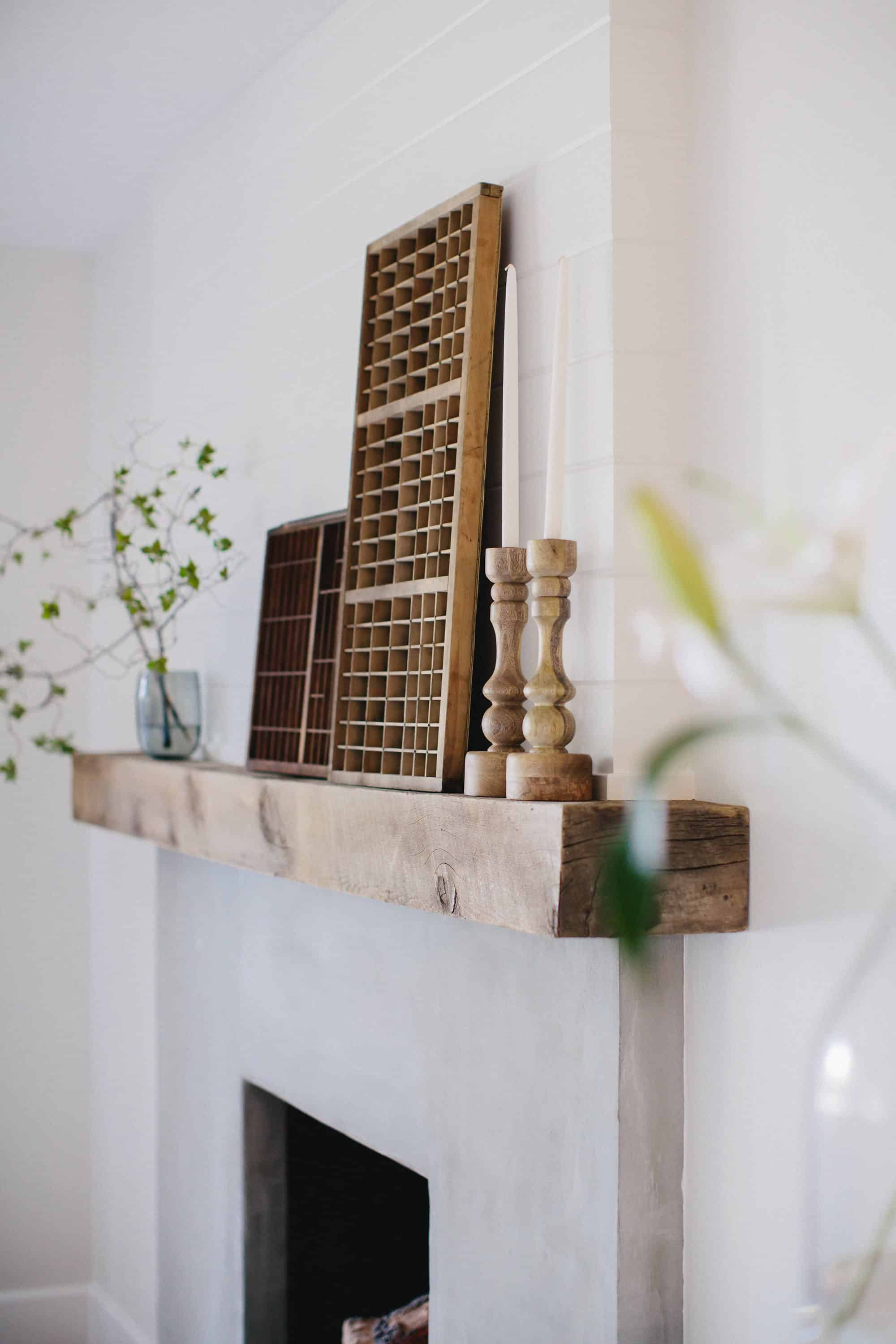 Update an old brick fireplace by using cement! This brick fireplace makeover completely transforms this living room!
