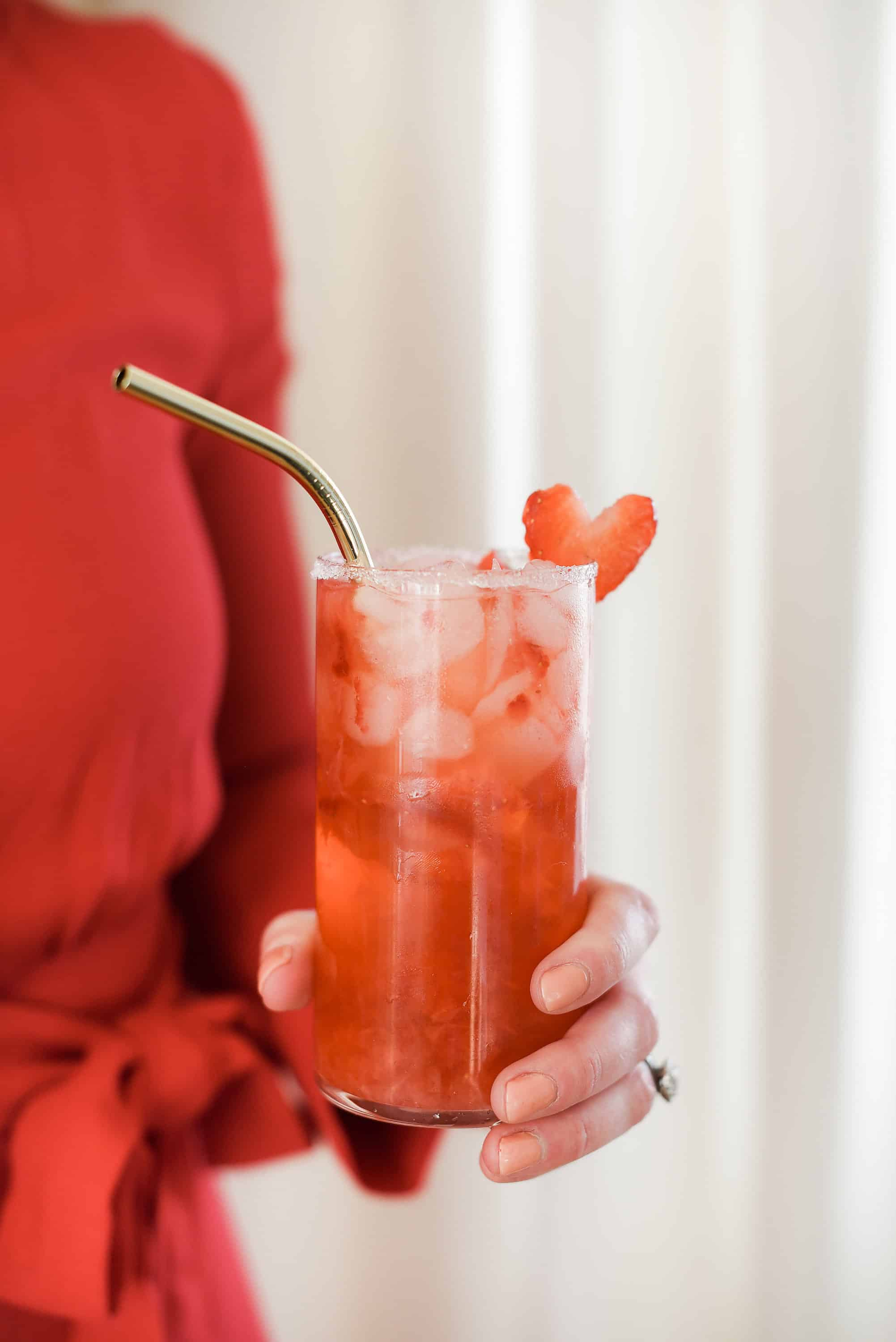 This strawberry champagne cocktail is the perfect thing to serve this Valentine's Day! Made with crushed strawberries and rosé champagne, you will love this delicious cocktail for Valentine's Day!