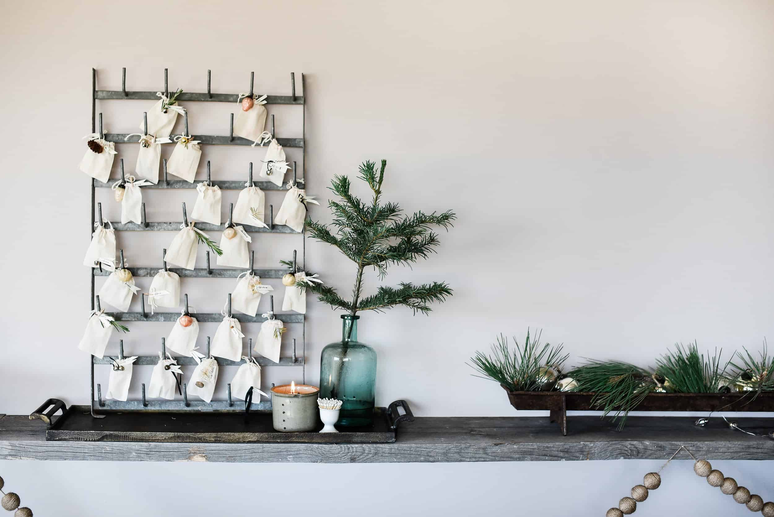 This vintage wall mount herrison (or bottle drying rack) is the perfect place for our DIY advent calendar this year! Each bag is filled with candies, activities, or bible verses.