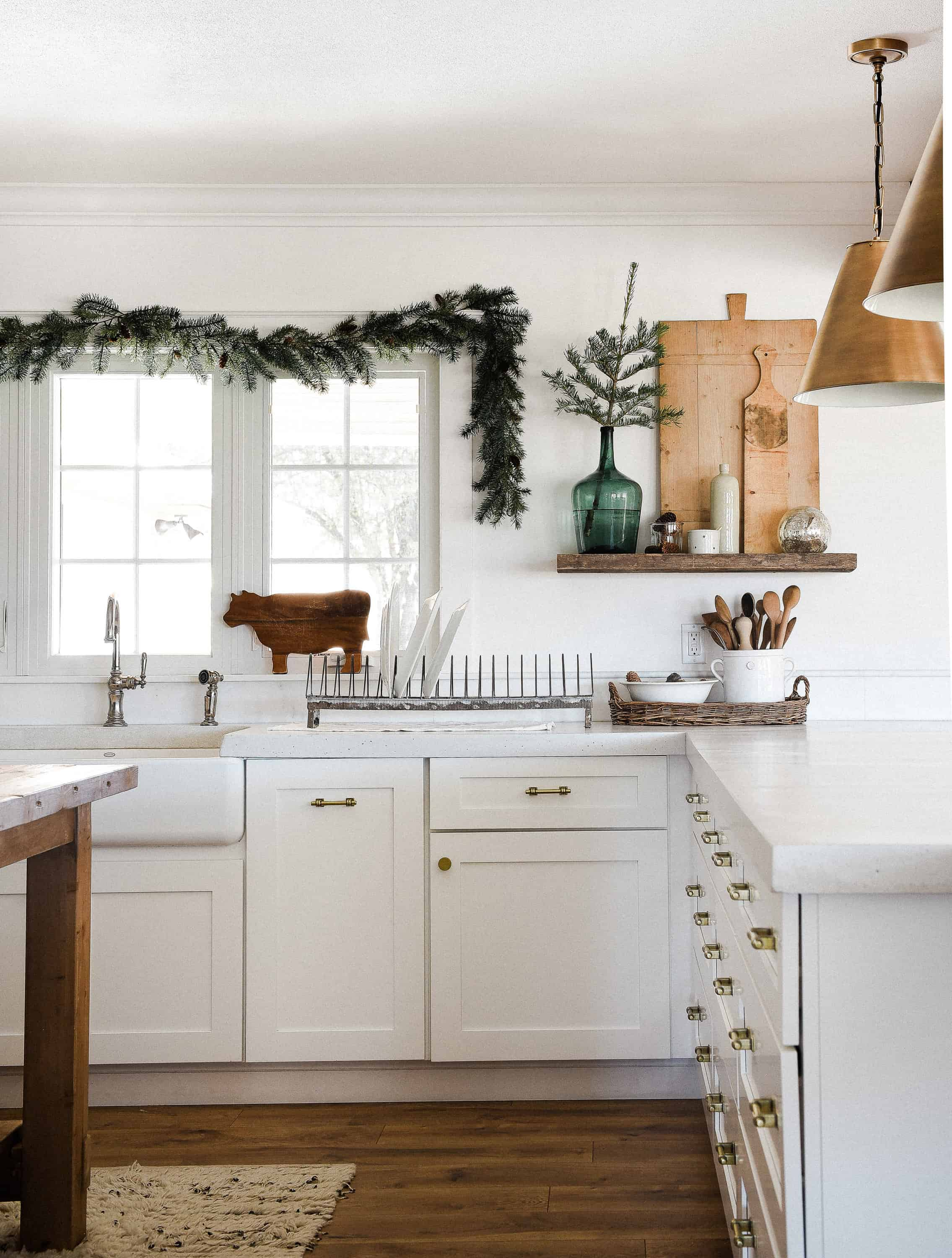 Tour our Christmas kitchen to gather ideas for decorating for the holidays this year! Use greenery and vintage touches to keep things simple and cohesive!