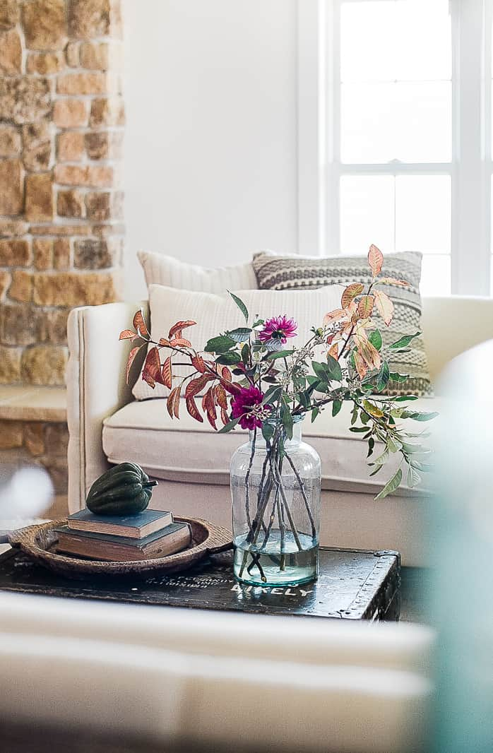 Some simple ways to update your living room this fall with farmhouse inspired decor and vintage touches!