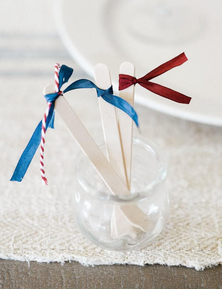 Try this simple 4th of July party idea this year to dress up cocktails and drinks! All you need is a popsicle stick and some ribbon scraps!