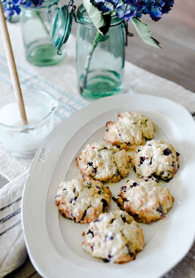 Blueberry scones with a lemon glaze are easy and delicious! A tried and true recipe to keep in your back pocket!