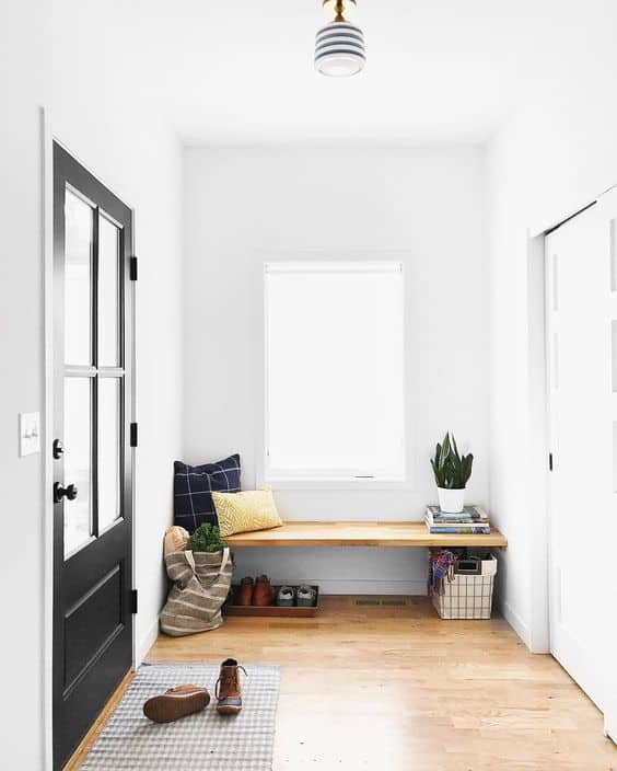 Update a cramped entryway with a built in bench! These built in benches will inspire you to makeover your entryway!