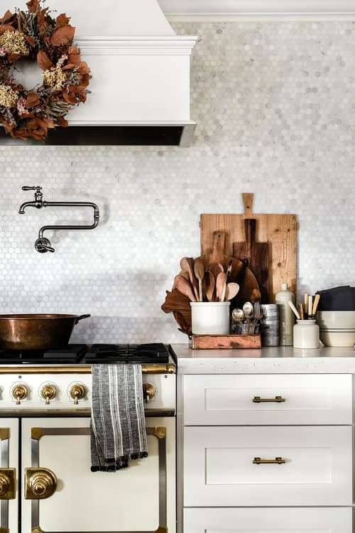 The most common questions I receive about our home, are regarding our kitchen cabinets. Where are they from? What color paint did you use? Do you like them? Well, today I am going to break down every last little bit of our cabinets for you!