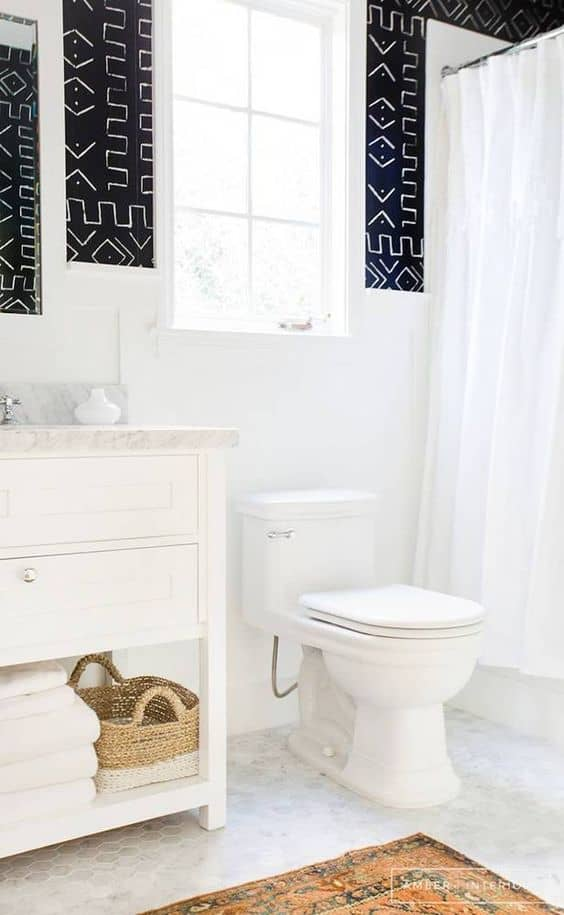 Using wood tones, brass fixtures, and lots of marble, our guest bathroom is getting a modern refresh.
