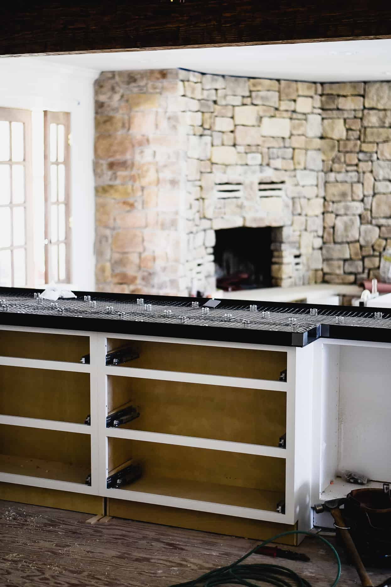 What I've learned about white concrete countertops in our kitchen! Should you DIY or hire a professional?Learn all about cement kitchen countertops…let's go!