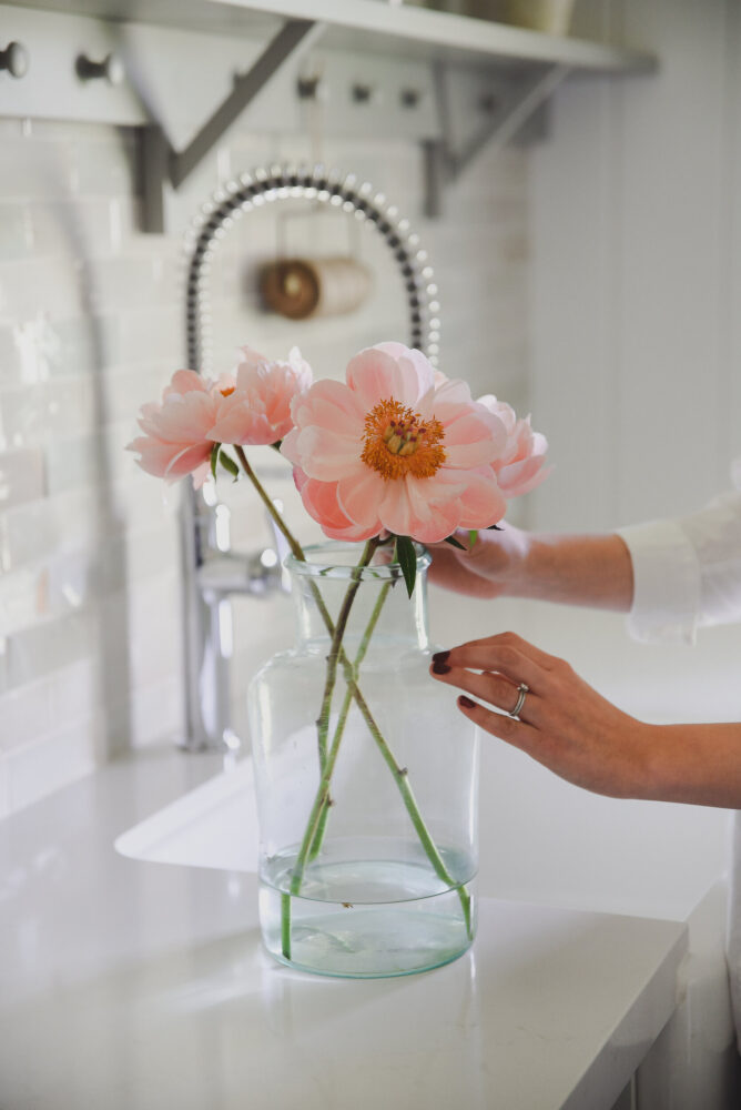 Pink peonies in glass vase in farmhouse kitchen boxwoodavenue.com