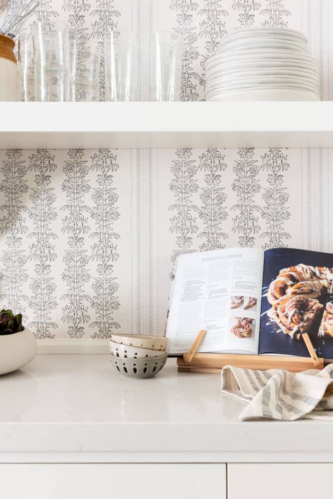 Wallpaper background in kitchen vignette with floating shelves by Studio Mcgee