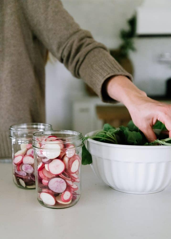 Sliced radishes in mason jars