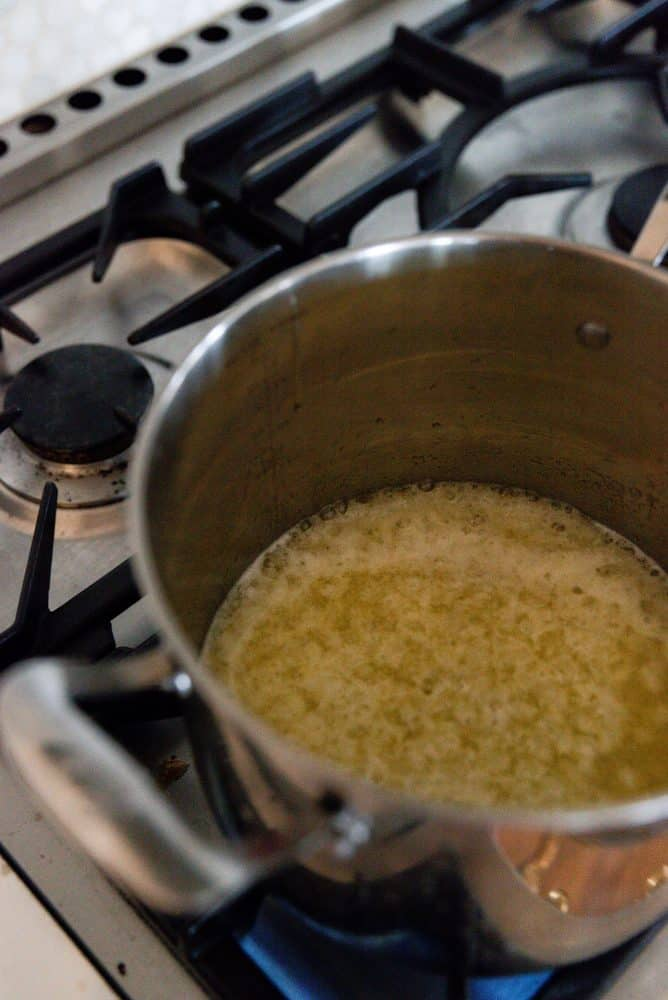 Butter & sugar melting in large pot for caramel sauce