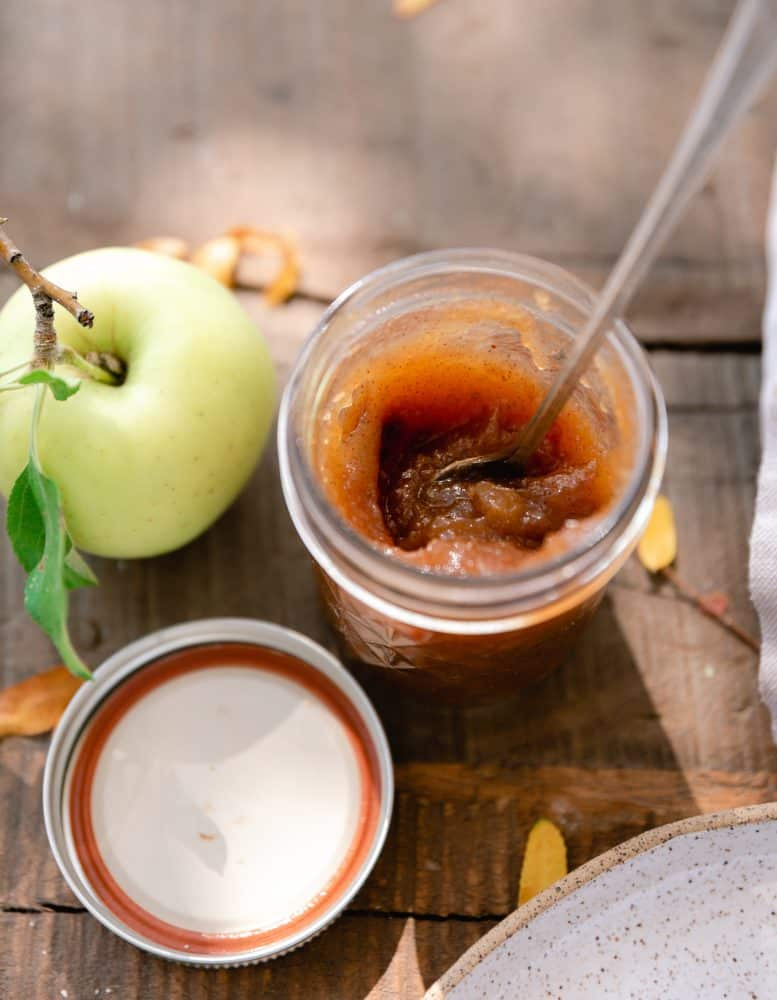 Jar of apple butter on table