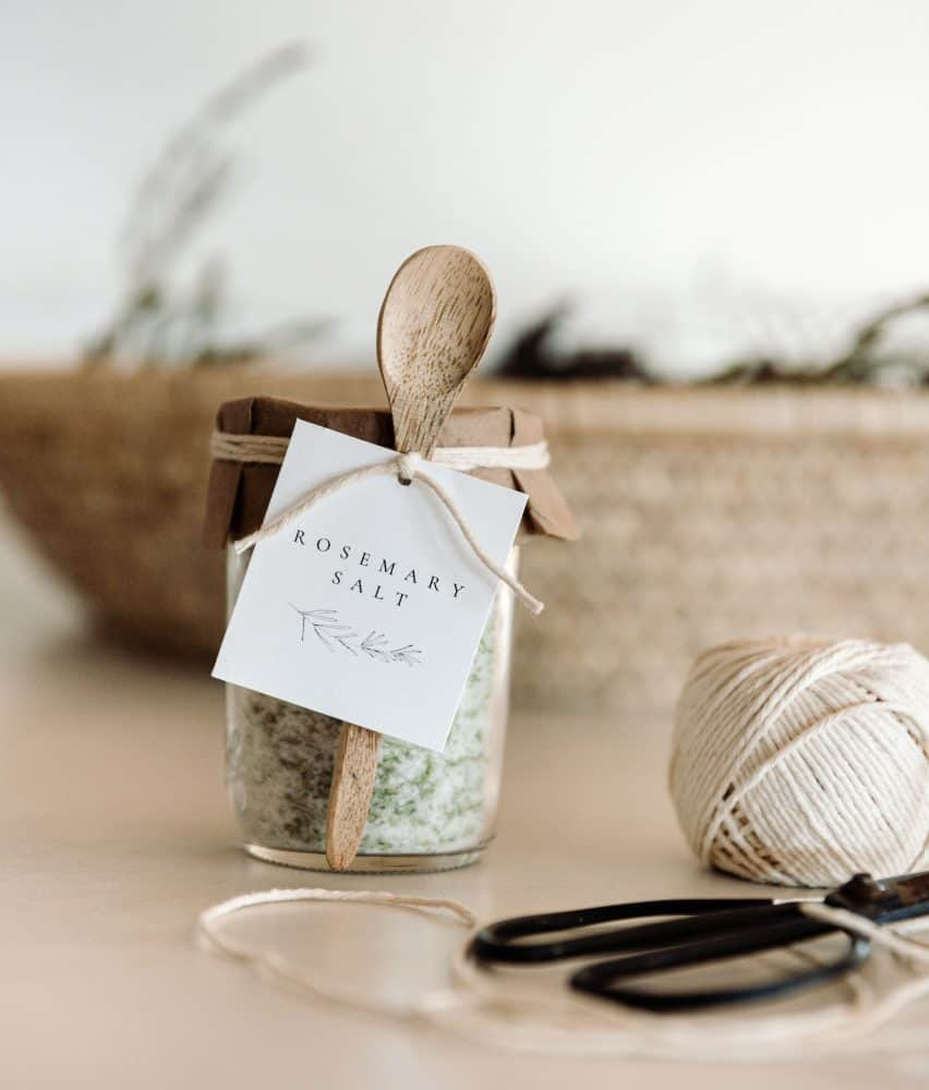 Jar of Rosemary Salt in Ball Canning Mason Jar with Gift Label and Small Wood Spoon