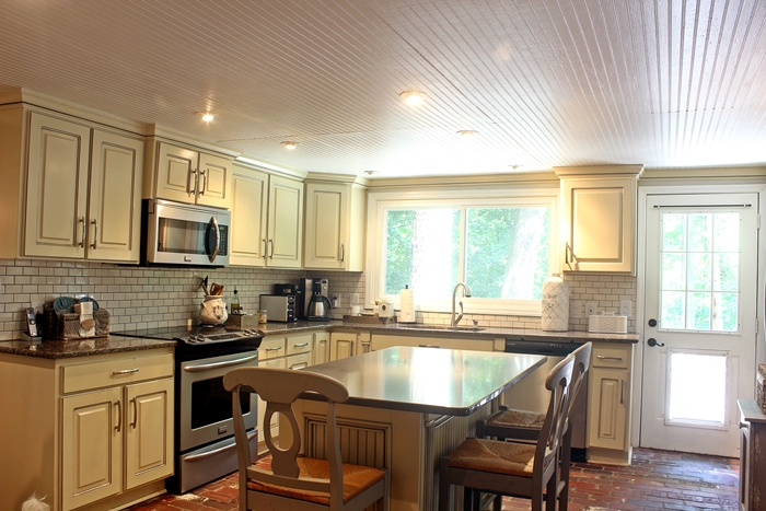 French country or cottage kitchen with beadboard ceilings