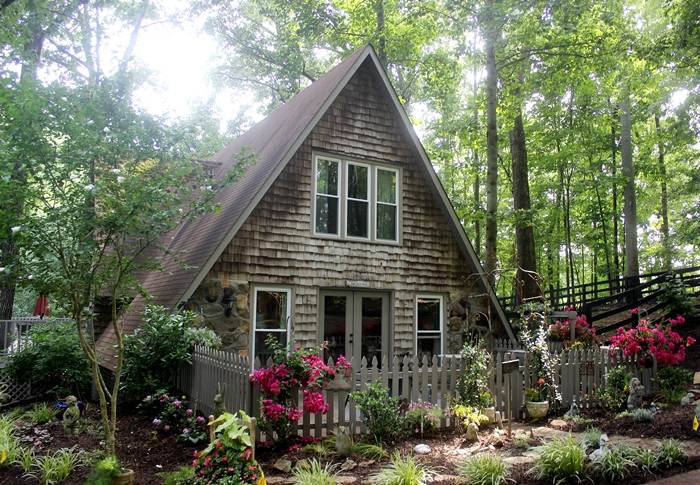 A-frame cottage exterior w/ cottage garden and landscaping