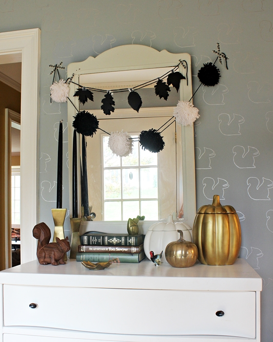 black, white, and gold fall/Thanksgiving display in entryway