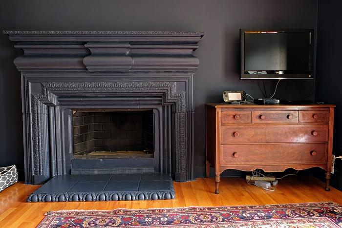 Benjamin Moore Hale Navy walls and fireplace