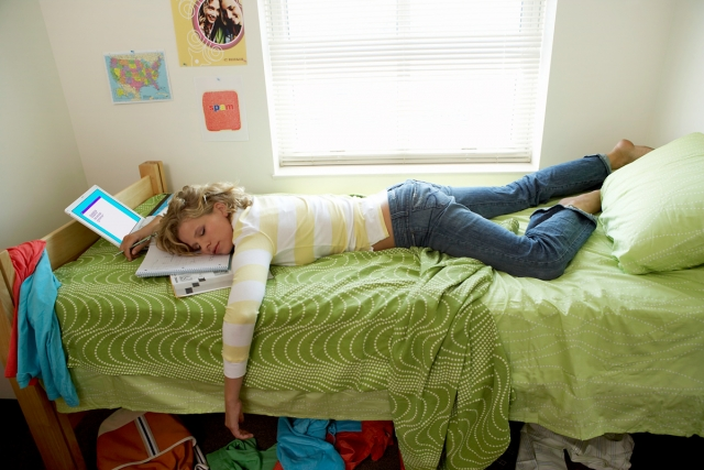 young-woman-sleeping-on-bed-in-student-dorm_pop_13964.jpg