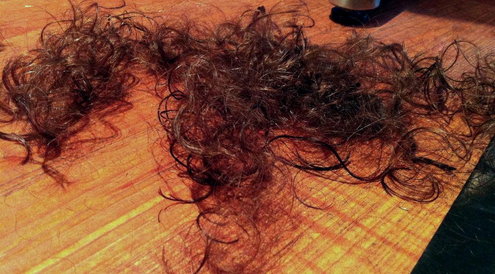 Hair cuttings on the floor.