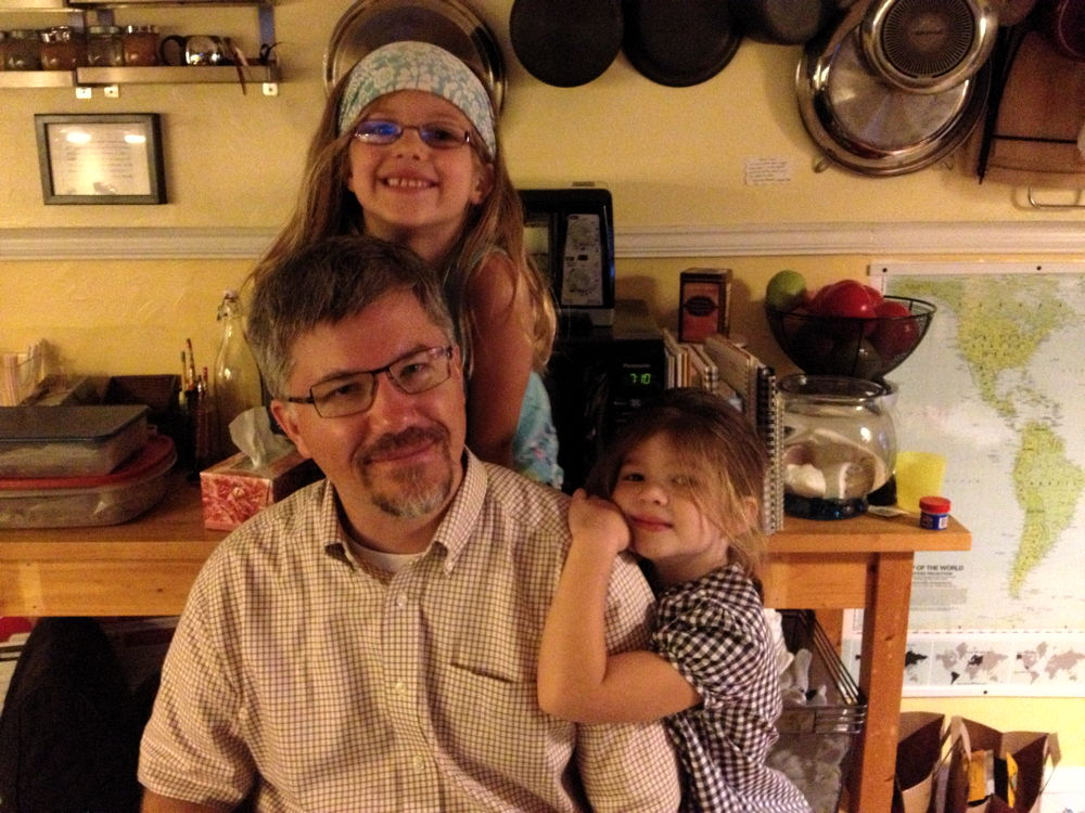 Jon and his sweet daughters.