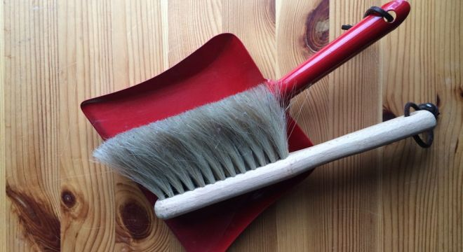 Whisk broom and dust pan.