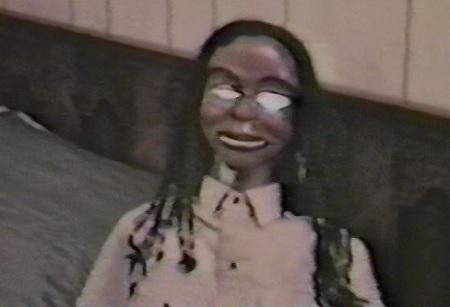 black devil doll from hell demon eyes