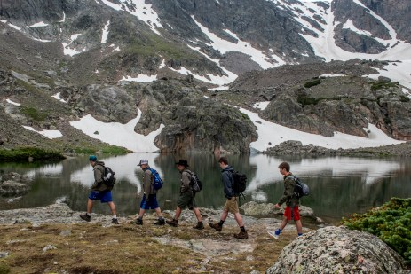 Scouts from PA hike during a cloudy, rainy day on the trail to Sky Pond, in Rocky Mountain National Park, Colorado