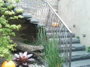 The Sanchez house entry again. Floating stone steps and an awesome tribal art bench.