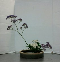 Slanting Moribana, Variation #4. Yarrow and statice, and leaves from a Griselinia tree.