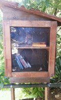 """I came across this """"free bookstore"""" on the front fence of someone's garden! It's on the steps that are 22nd St, above Diamond."""