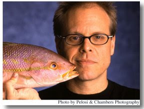 Alton Brown with a fish