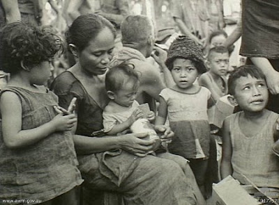 Philippines People Filipino Pinoy Pilipinas Old Black White Pictures evacuation leyte world war II WWII family boy girl mother baby child noon