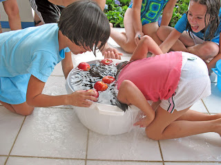 Erica Ridley in Costa Rica: bobbing for apples