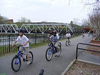 Children biking by the river in Columbia