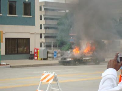 lansing police car burns obama