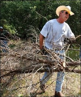 President Bush clears brush from his ranch in Crawford, Texas. It's part of his workout routine at the ranch.