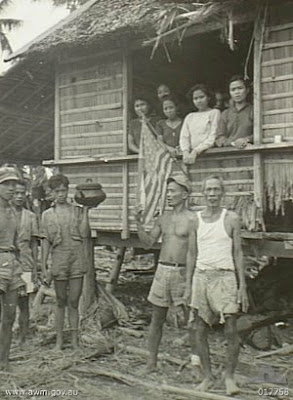 Philippines People Filipino Pinoy Pilipinas Old Black White Pictures evacuation leyte world war II WWII nipa hut street scene noon