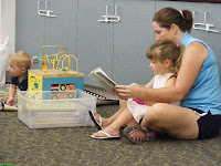 Fun reading with her mother
