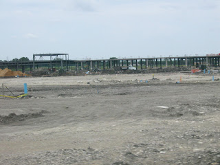 Earth being pounded and dug up for commercial development