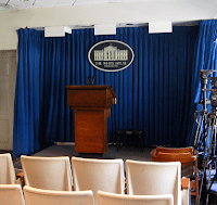 Empty White House press briefing room with an empty podium.