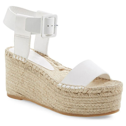 $295 BUY NOW This platform wedge is not only trendy, but it provides a nearly even pitch. Translation: you'll get a 3.5-inch lift, but have the feeling of wearing flats. Genius! Plus the white leather is perfect for summer.