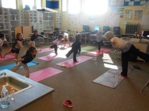 "Kindergarteners ""take flight"" with yoga enrichment once a week."